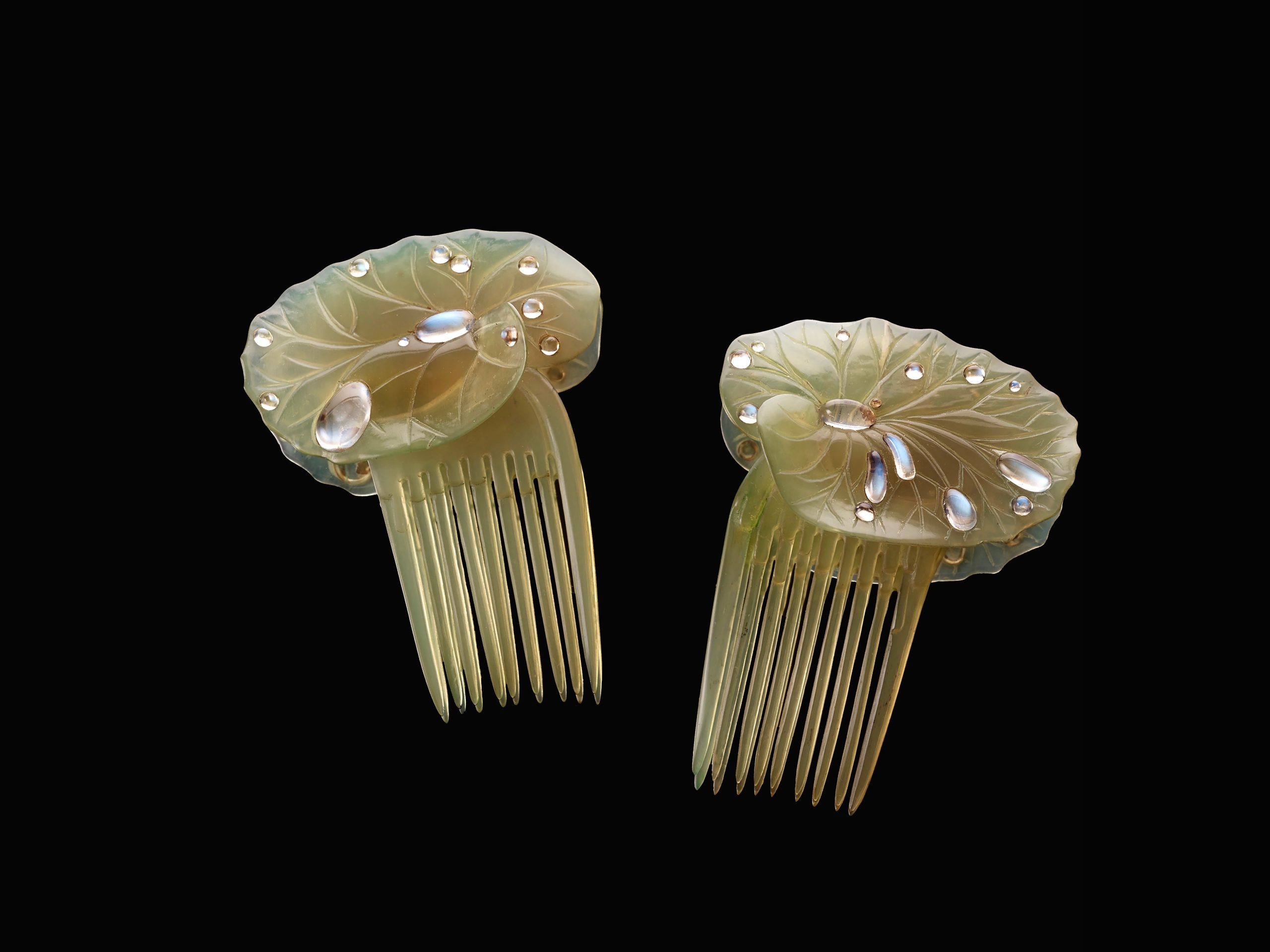 It is possible to be stunning and subtle simultaneously. British artist Ella Naper made her 'lily-pad hair combs' from horn and moonstone circa 1906. (photo: John Faier © The Richard H. Driehaus Museum)