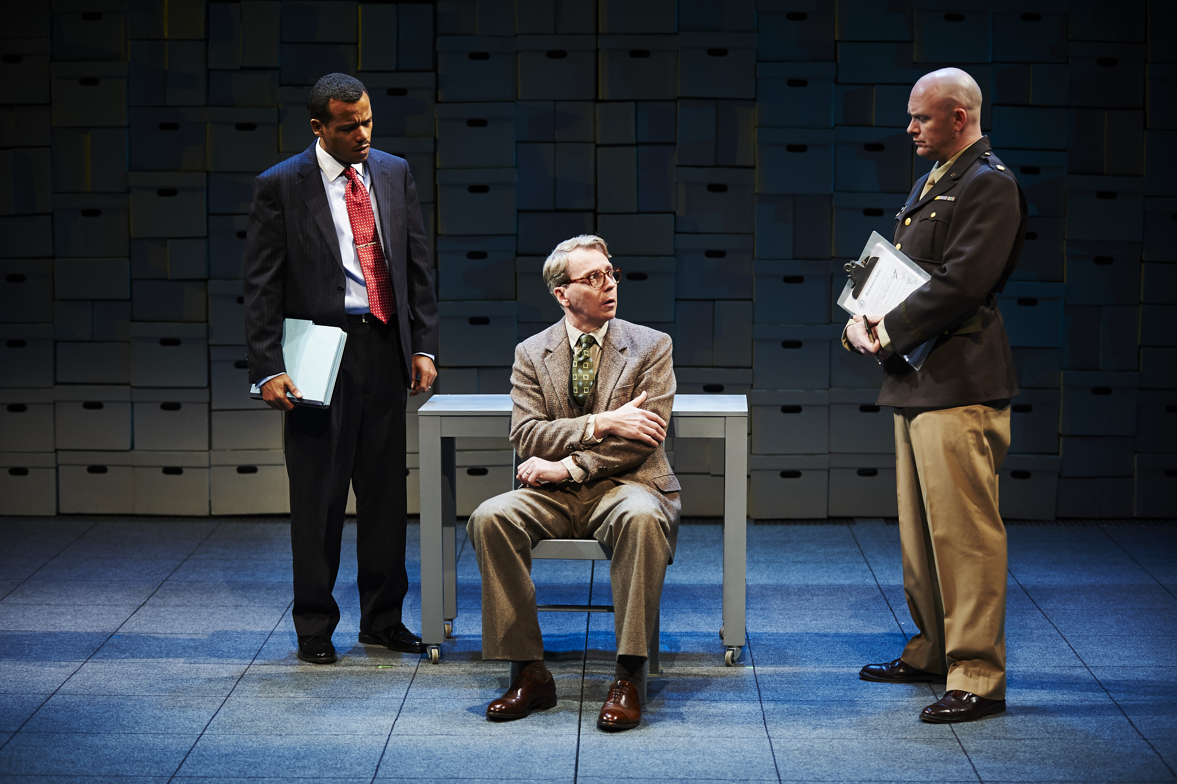 """It is not looking good for ex-Nazi Arthur Rudolph (Jonathan Tindle, center) in City Theatre's new production, although the play is called """"Some Brighter Distance."""""""