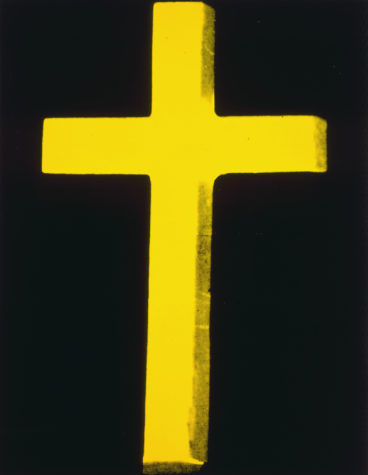 In the 'Revelation' show, Warhol's large yellow 'Cross' is paired with a red one. Together they bracket one of his 'Skull' paintings.
