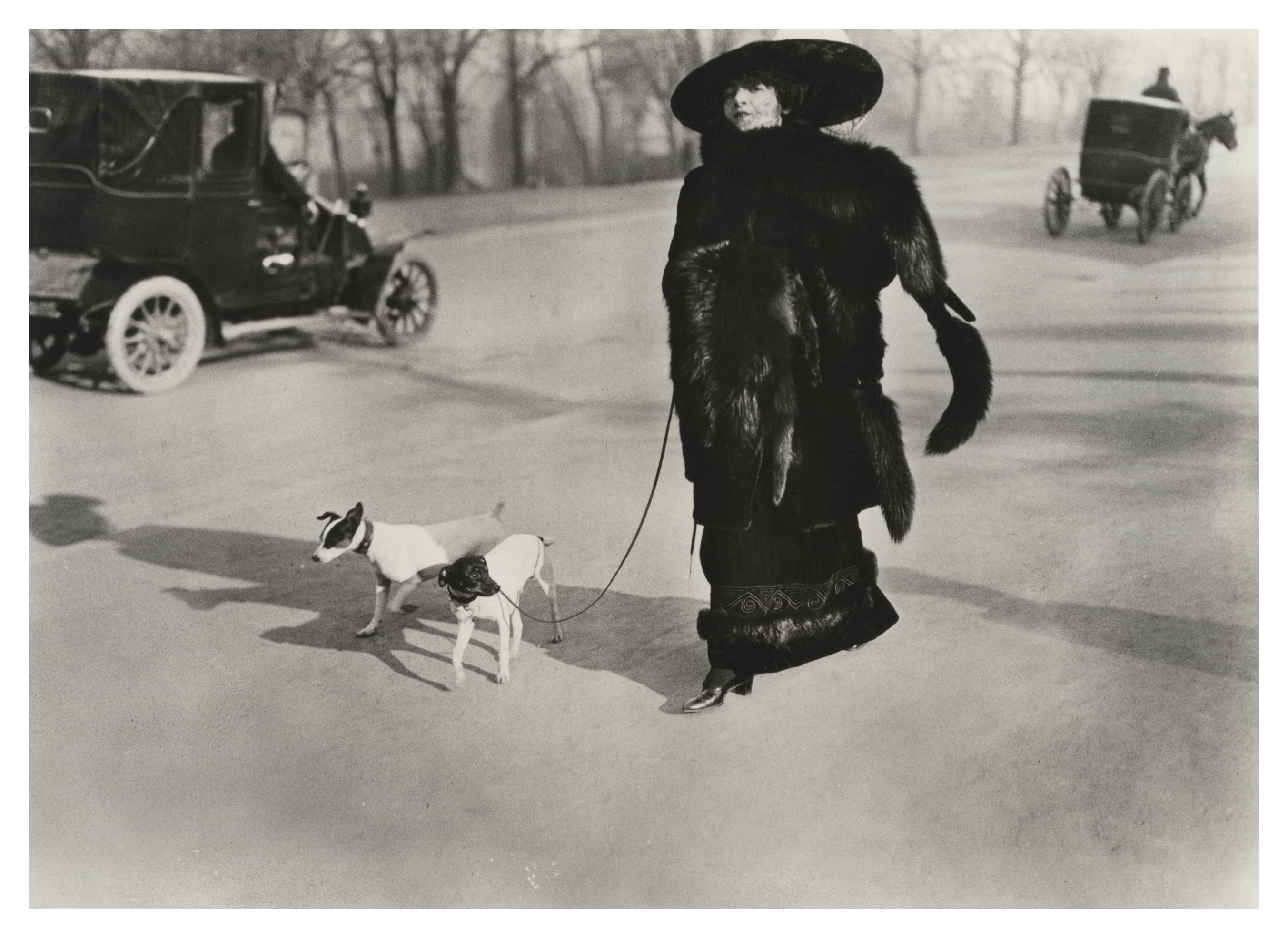 Lartigue had an eye that caught a changing world on the fly. This foxy lady of 1911—decked in dead foxes down to the ankles—displays the over-wrapped, woman-as-parade-float style that will soon become as obsolete as the horse-drawn carriage receding in the distance.