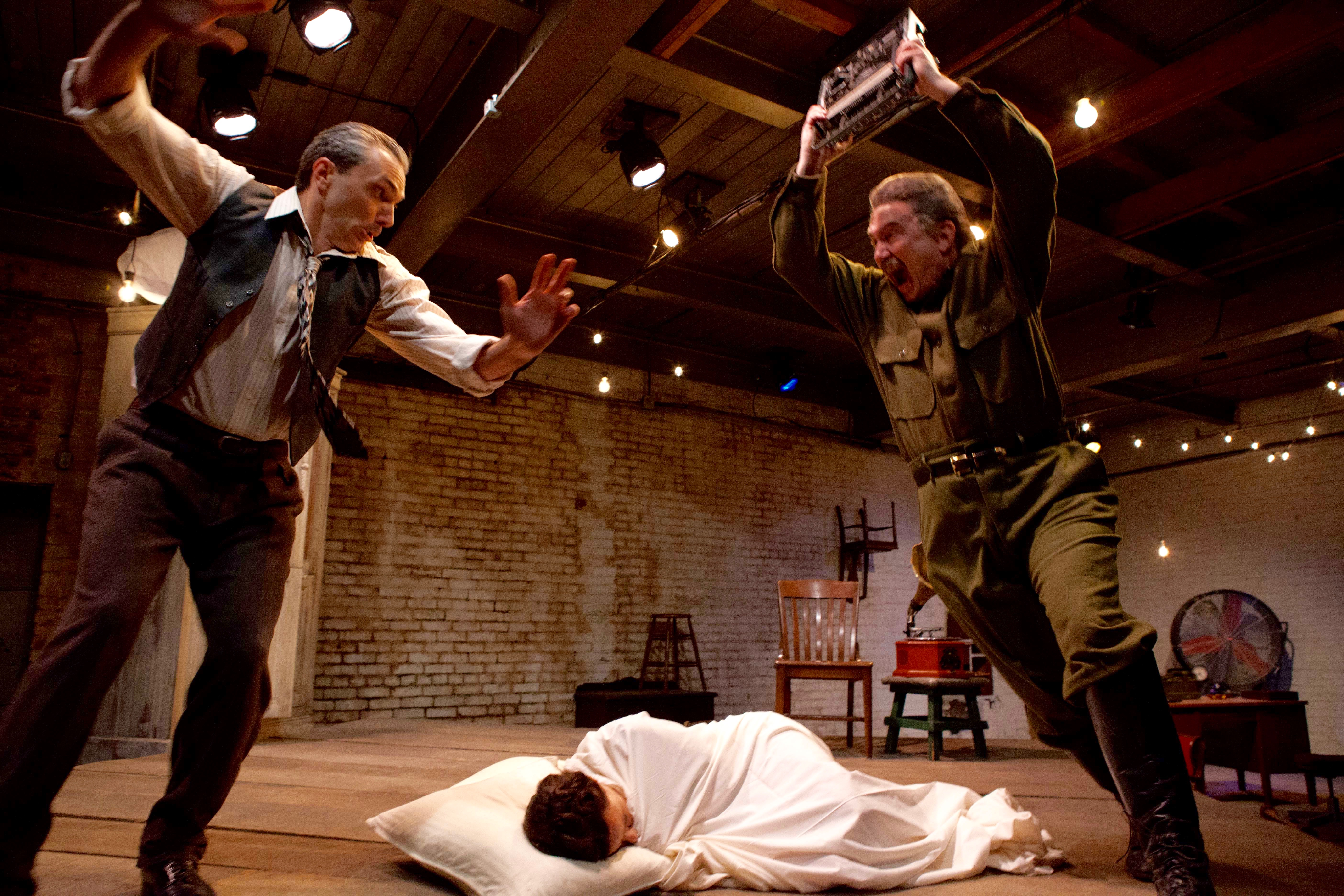 Bulgakov (Anthony Bingham, L) and Stalin (Martin Giles) engage in spirited dialectics while Bulgakov's wife Yelena (Dana Hardy) tries to sleep it off in 'Collaborators.'