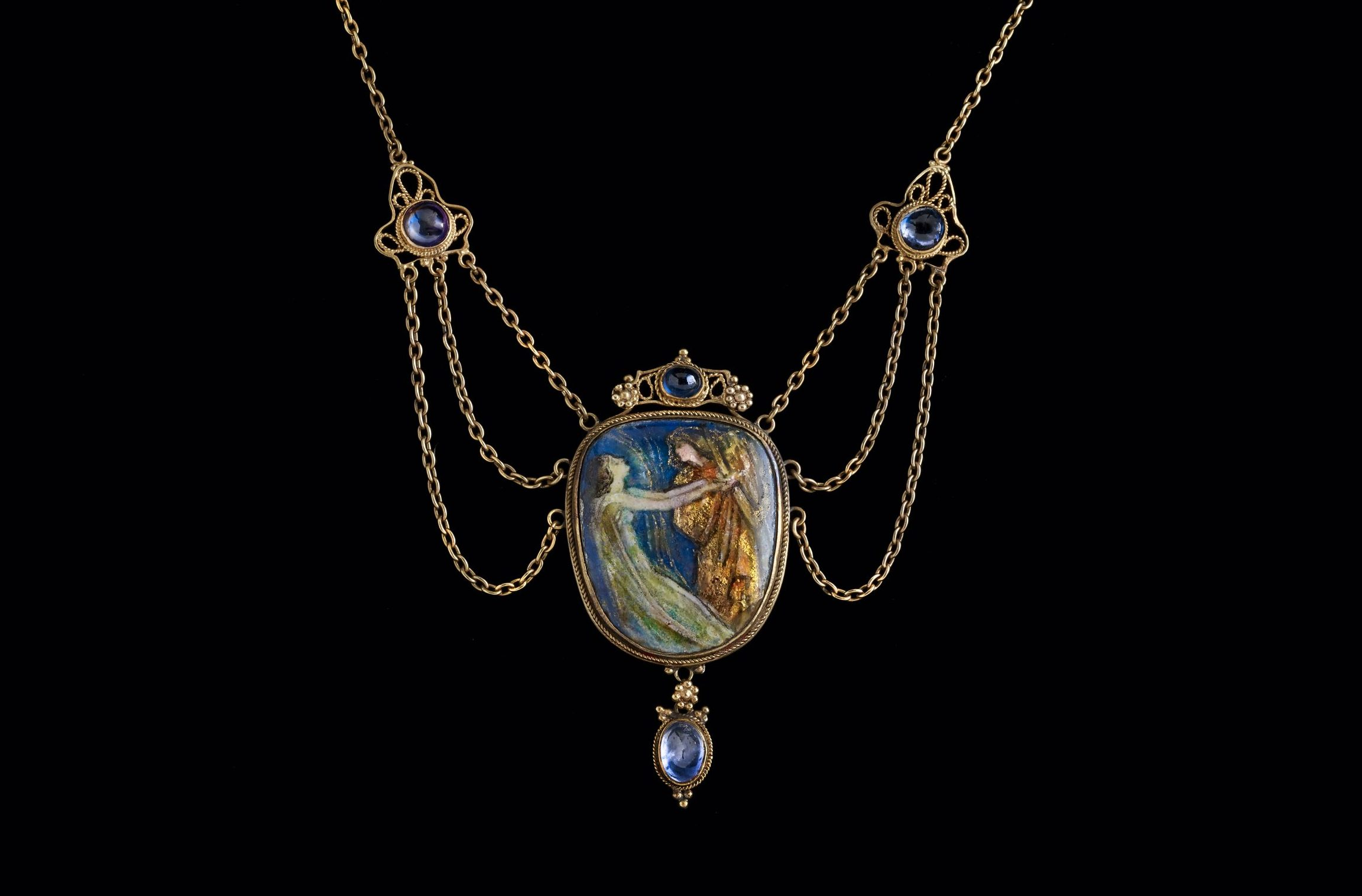 Inspired by Arts and Crafts principles, this necklace is attributed the Guild of Handicraft in London circa 1900. The overall design is ornate but has a palpable unity and the enameled image evokes days of yore. (© Artists Rights Society / ADAGP. Photo: John Faier, © The Richard H. Driehaus Museum.)