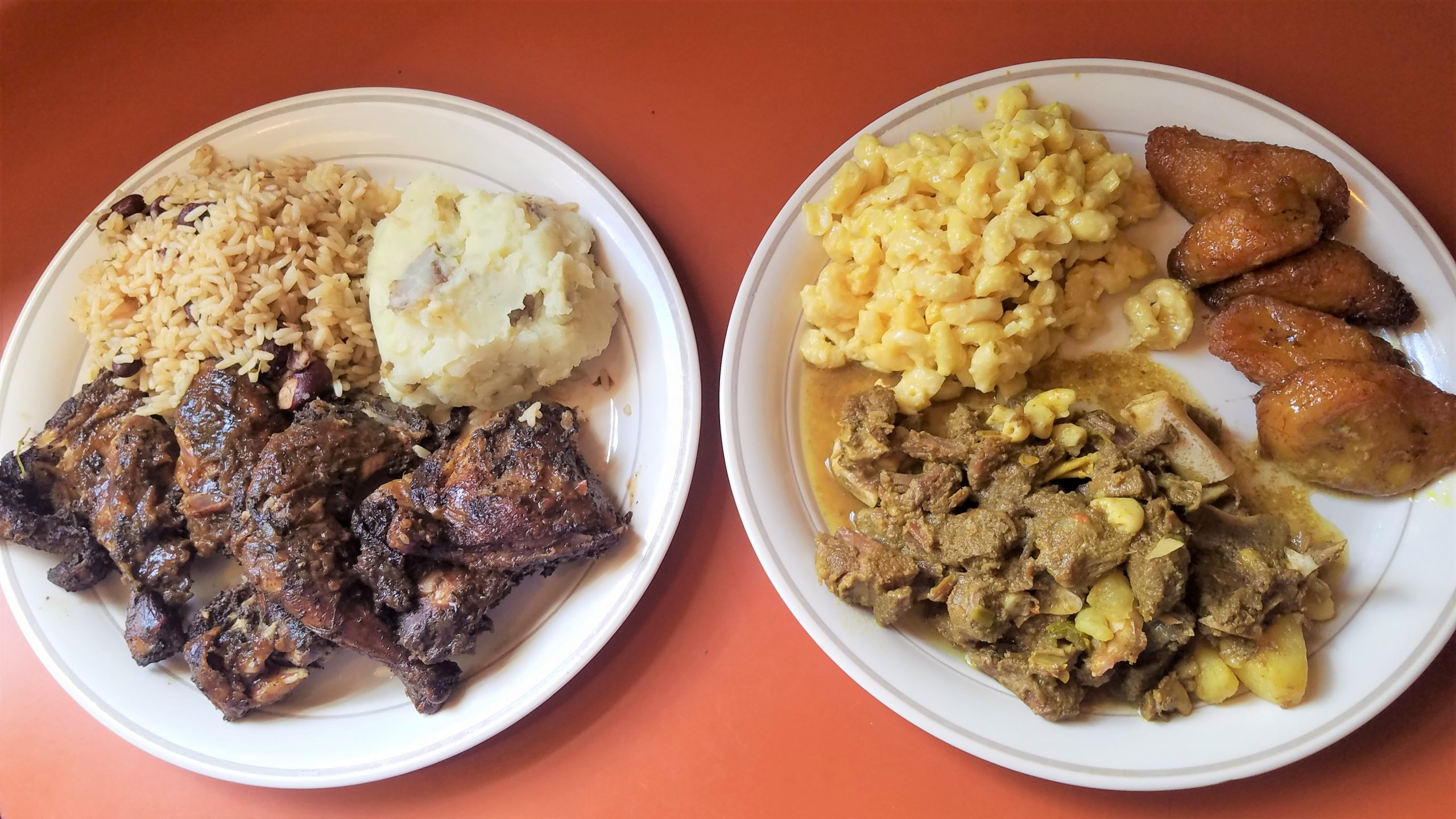 Jerk chicken with mashed potatoes, and beans and rice (l.); curried goat stew with mac and cheese, and fried plantains (r.). Takeout fare re-plated. (photo: Rick Handler)