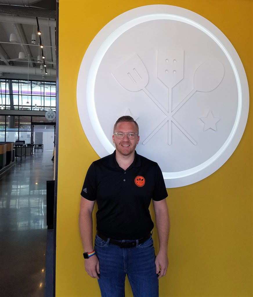 Chadd Ellingboe, CEO of the Galley Group in front of the logo at Galley Bakery Square.