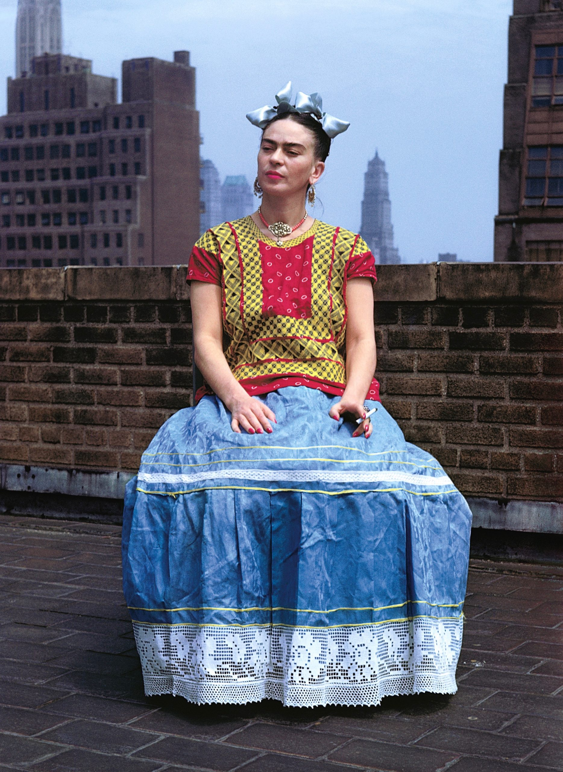Top of the world: Although the special exhibitions at The Frick are photo shows, with none of Frida Kahlo's art on display, this 1946 picture is very much in the style of her painted self-portraits. The photographer was Nickolas Muray. (Image © Nickolas Muray Photo Archives)