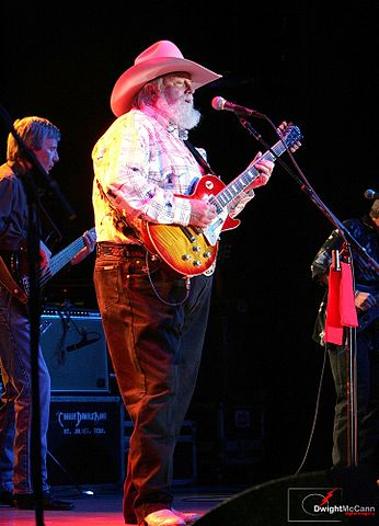 Charlie Daniels is highly skilled at both the fiddle and guitar.