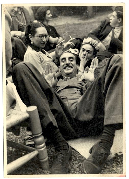 The Frick Pittsburgh's Kahlo photos range from high-art compositions to snapshots like this. The illustrious gentleman in suede shoes is painter and film director Adolfo Best Maugard. Arts patron Malú Cabrera Block is the lady in specs and that's Frida giving a hand signal with nose in midst. (Photo undated and unattributed, from The Vicente Wolf Collection)