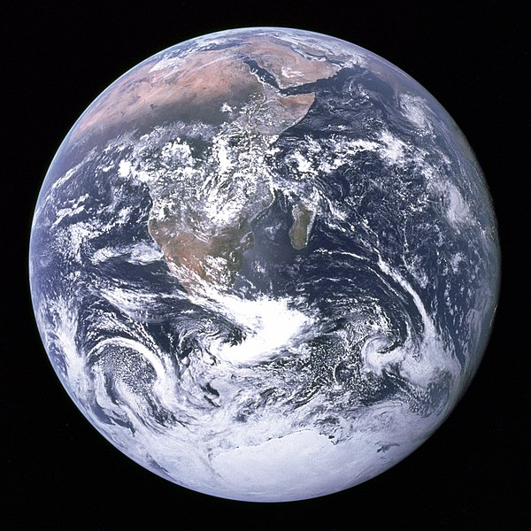 """The Blue Marble"" is a famous photograph of the Earth taken on December 7, 1972, by the crew of the Apollo 17 spacecraft en route to the Moon at a distance of about 29,000 kilometres (18,000 mi). It shows Africa, Antarctica, and the Arabian Peninsula. (photo: NASA and Wikipedia)."