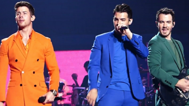 The Jonas Brothers performing on tour in 2019. (photo: musicharts and Wikipedia)