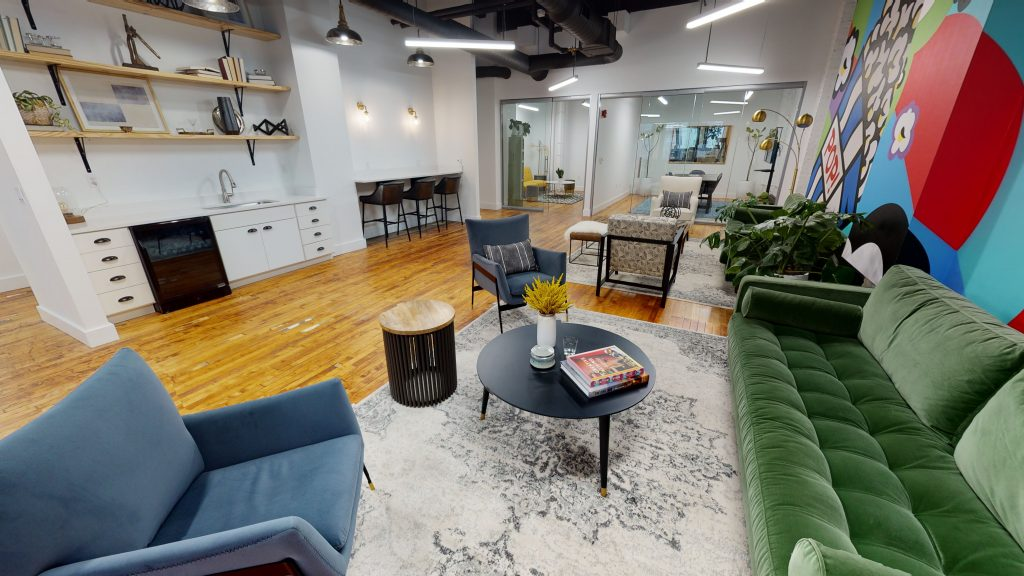 A contemporary office space in the Pickering Building replete with a mural from artist Burton Morris.