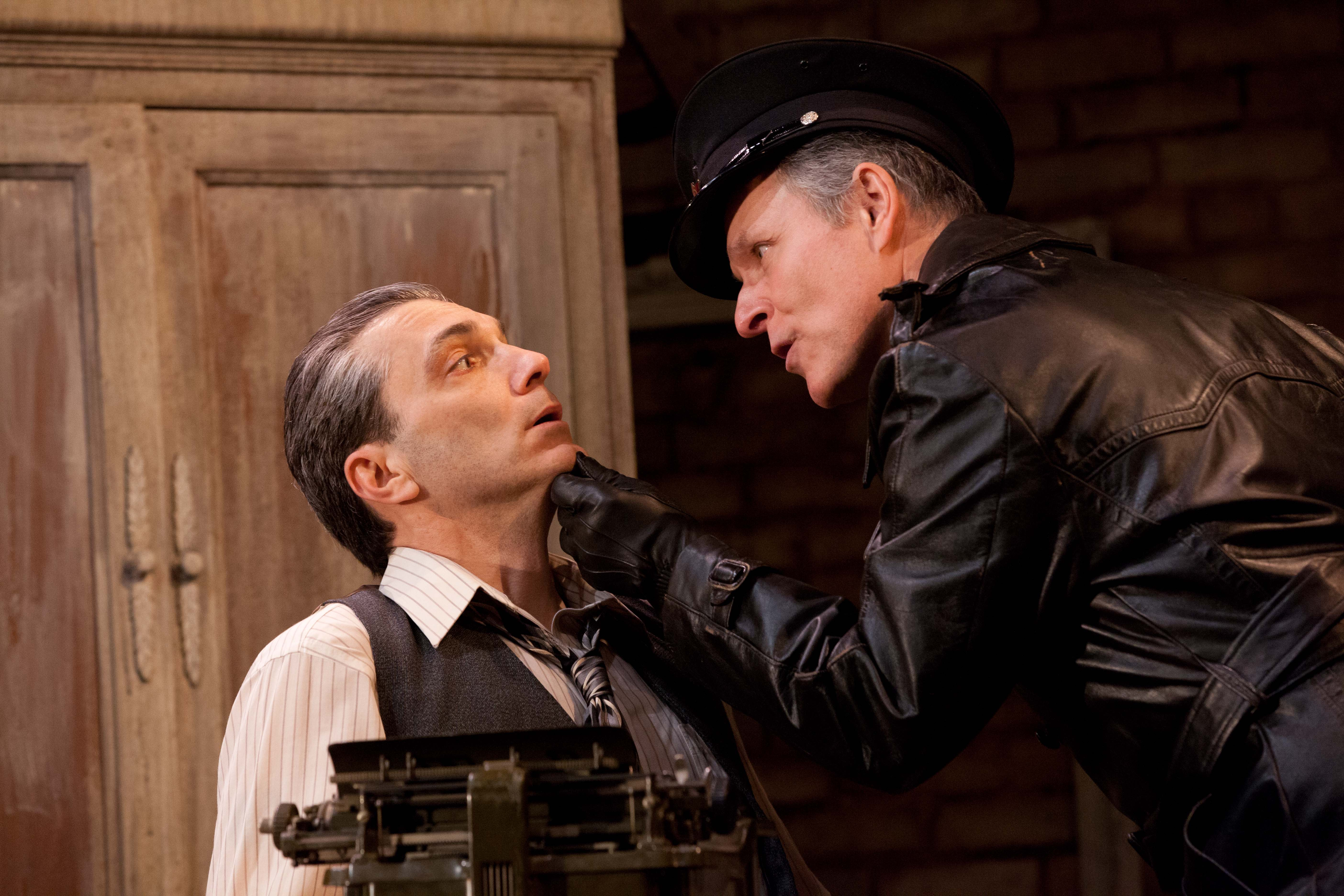 "In ""Collaborators,"" set in Stalin's Russia, writer Bulgakov (Tony Bingham, L) learns a new mode of artistic inspiration from secret police agent Vladimir (Ken Bolden)."