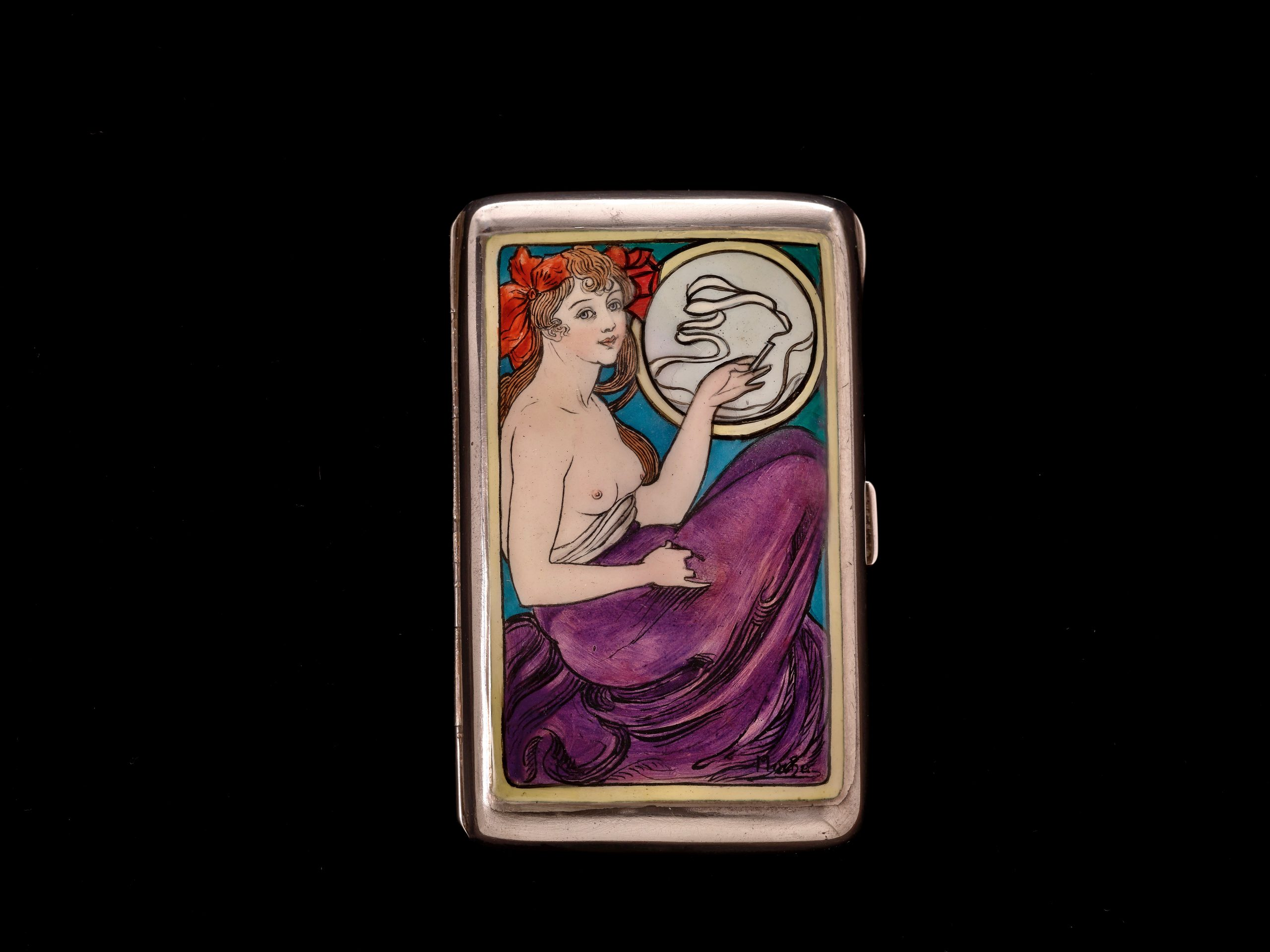 Czech artist Alphonse Mucha was known for epic paintings and florid Art Nouveau posters. He also felt that the muse on a silver cigarette case should have a ciggie of her own. (photo: John Faier, © The Richard H. Driehaus Museum)