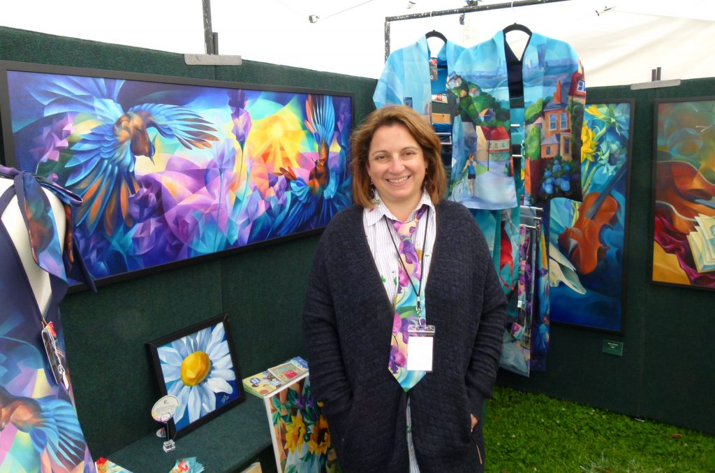 Pittsburgh artist Yelena lamm in front of her colorful paintings and clothing at the 2017 Fair in the Park. (photo: Rick Handler)