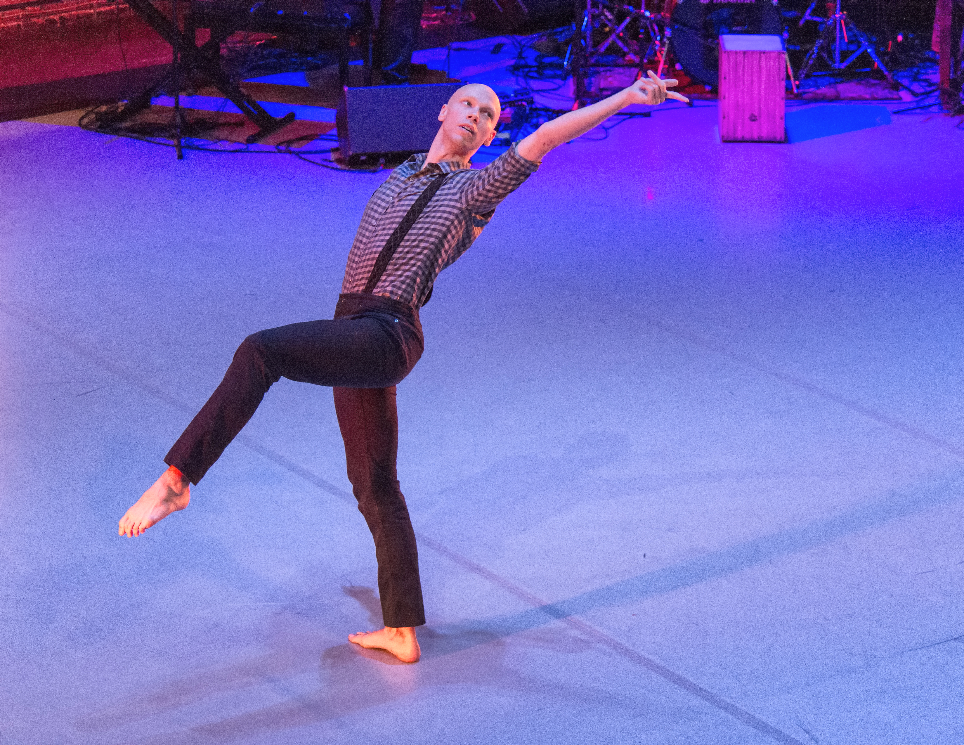 Attack Theatre's Dane Toney demonstrates that if you want to move forward, you put your left leg sideways and point another way, unless you want to head thataway ... and that's sort of how it goes in 'The Rube Goldberg Variations.' (photo courtesy of Dr. Robert Kormos)