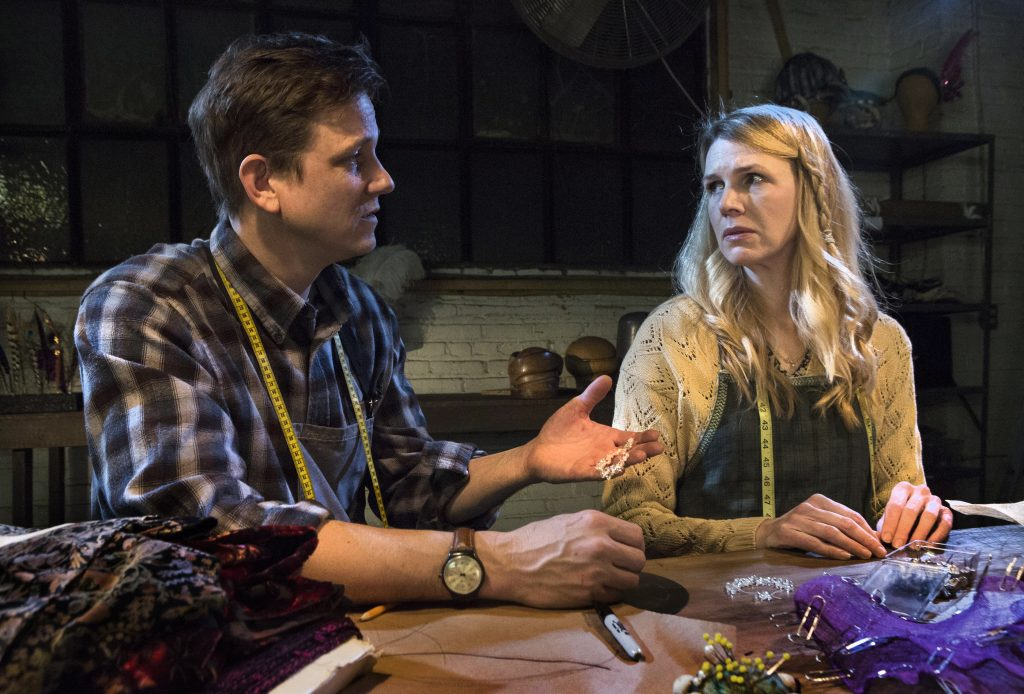 """Love blooms among the drudgery of work in a hat factory for Joan (Lisa Velten Smith) and Todd (Andrew William Smith) in Caryl Churchill's """"Far Away"""" at Quantum Theatre. (photo: Heather Mull Photography)."""