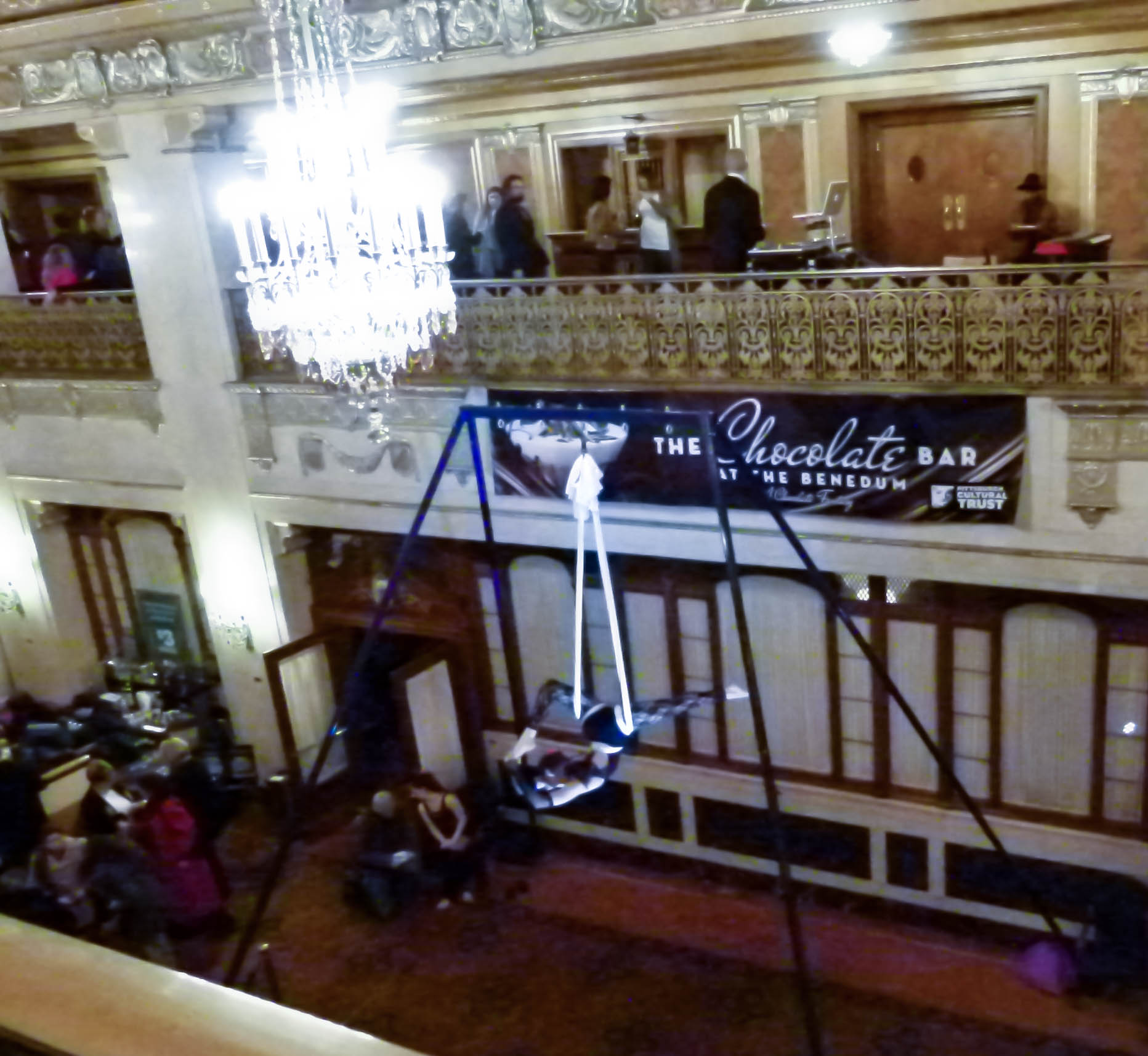 Kelsey Keller from Iron City Aerialists performs under the lobby's chandelier.