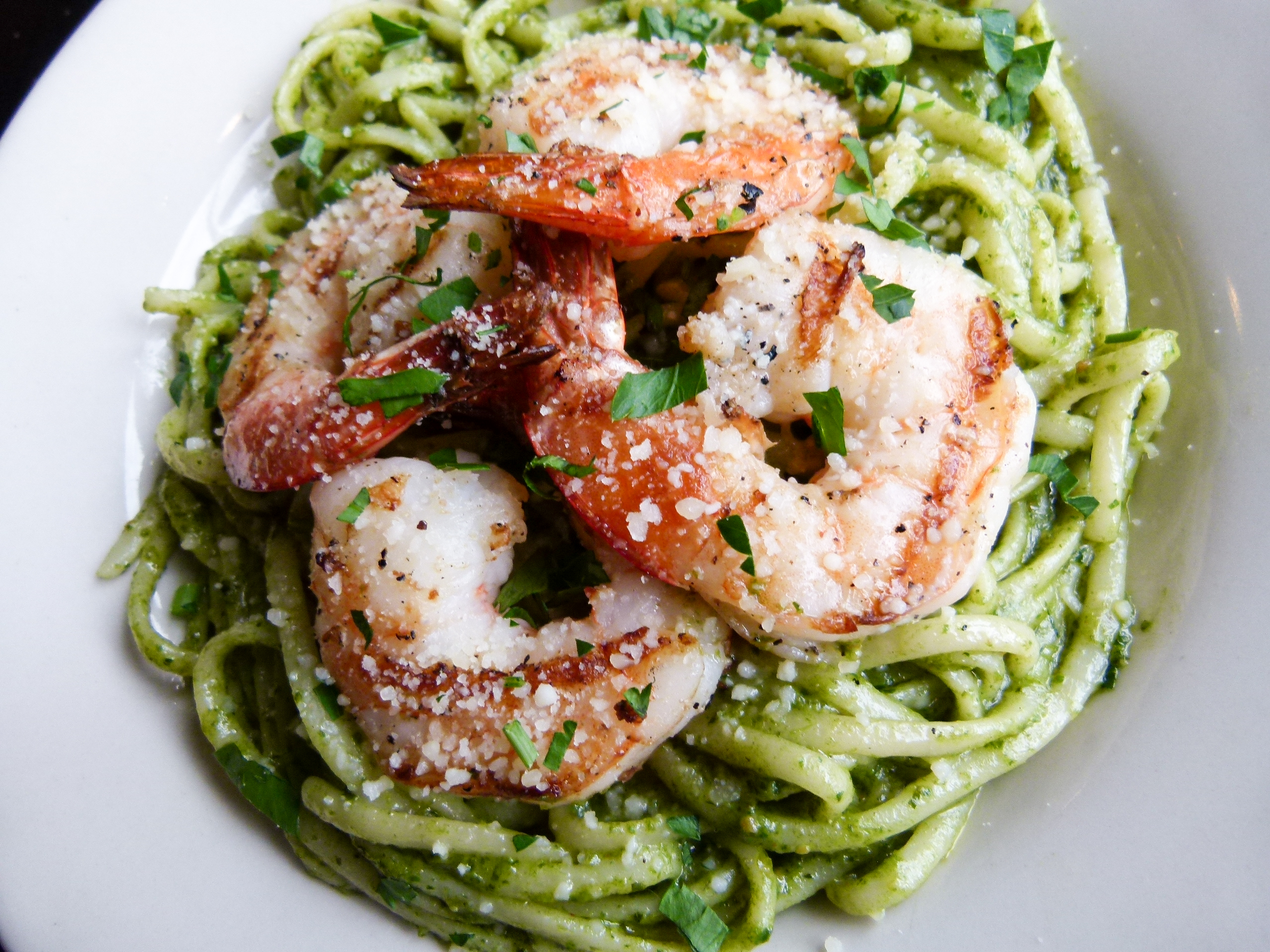 Linguini with pesto sauce and grilled shrimp.