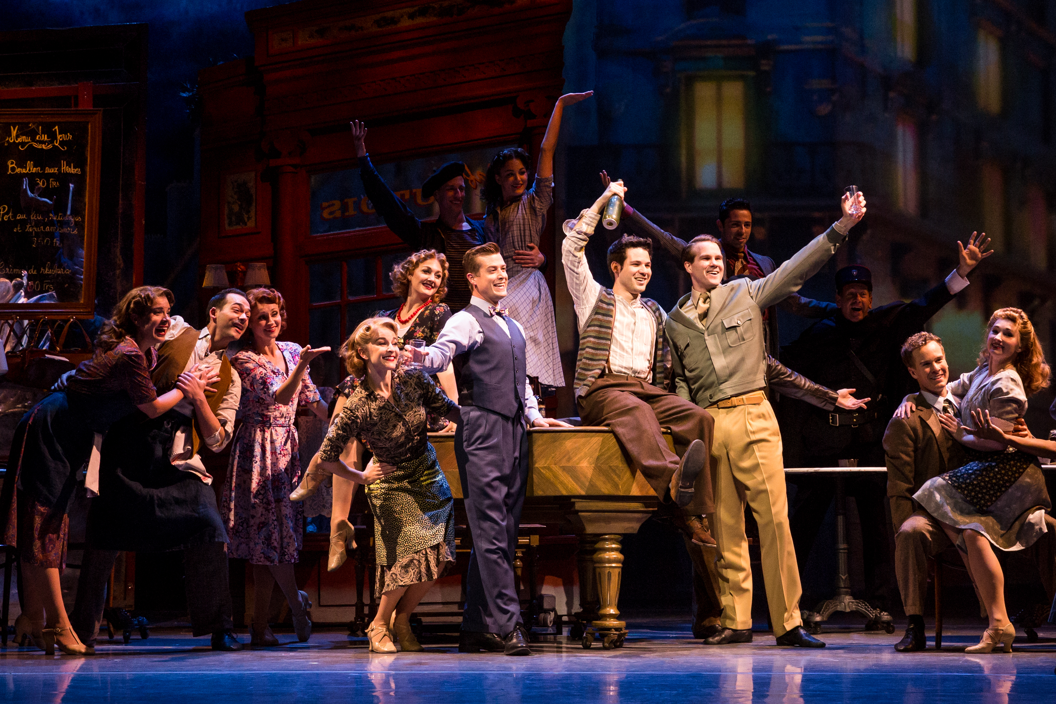 'An American in Paris' touring company in the French bistro. photo: Matthew Murphy.