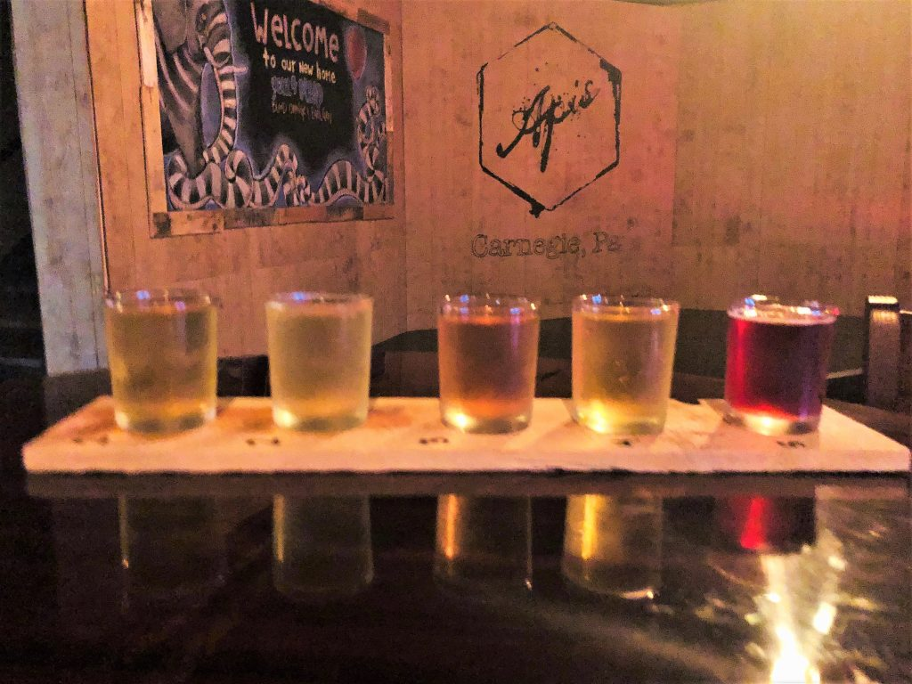 A flight of sweet Apis mead stands proudly before the new stage.