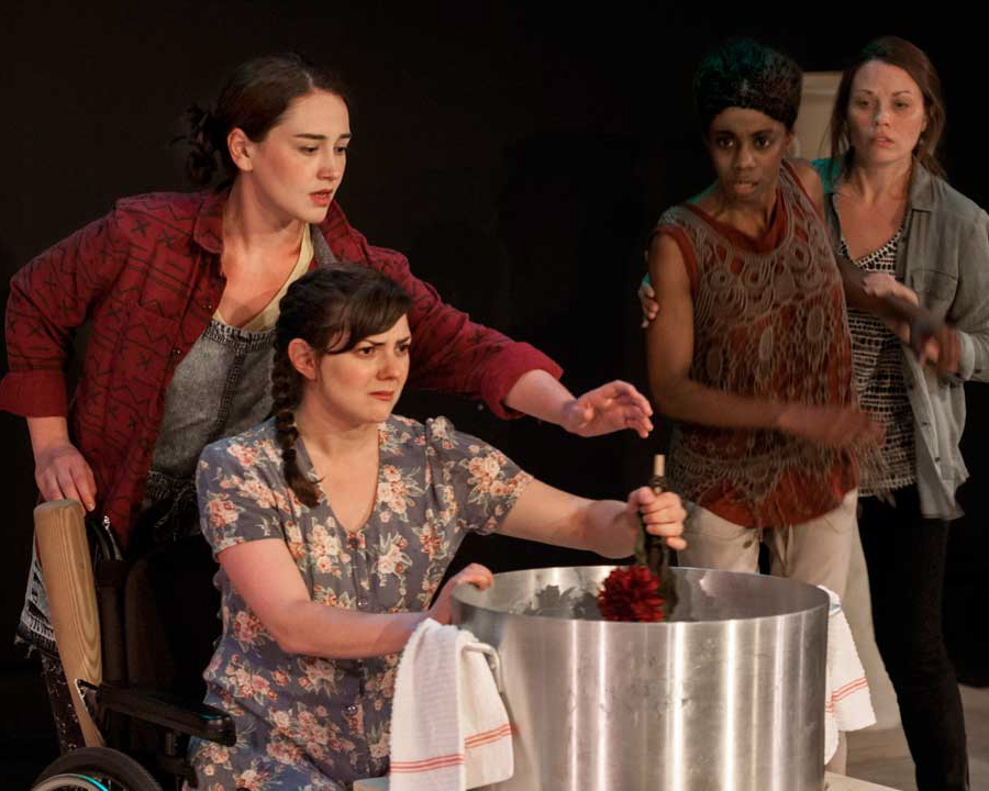"Babette (Tressa Glover, seated) stirs a mean brew in ""Brewed,"" as Lee (Moira Quigley) offers a hand while Juliette and Roxette (Siovhan Christensen, Kelly Trumbull) stand clear."
