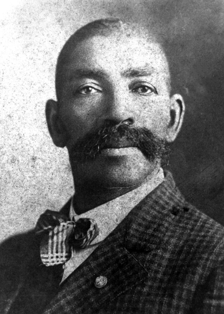 The picture is grainy but the eagle eyes are sharp: Western lawman Bass Reeves, real-life subject of 'Cowboy,' always got his man. (photographer and date unknown)