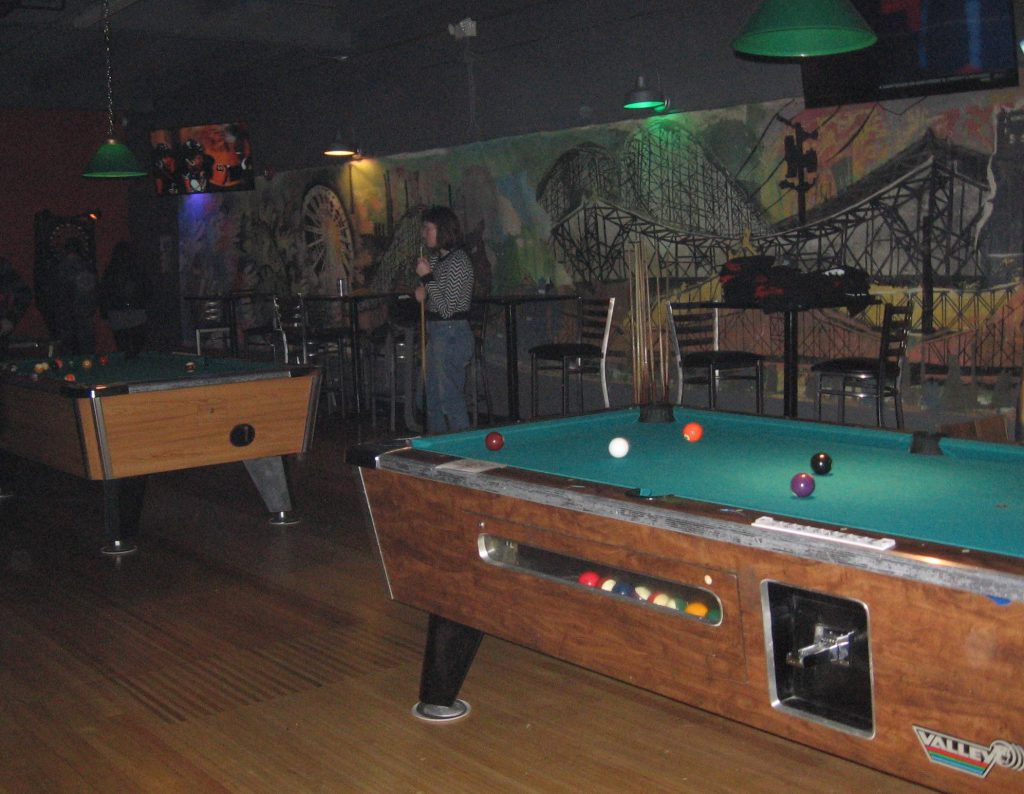 For those who don't feel like dancing, pool is another popular draw.