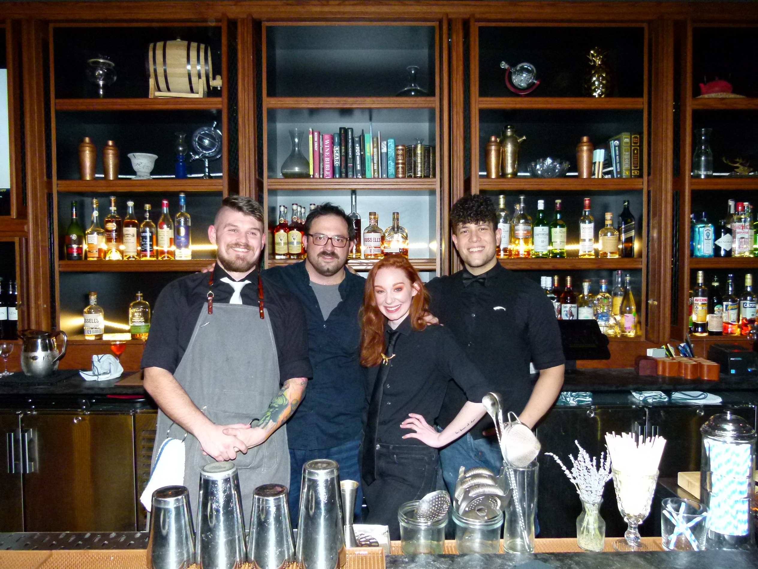 Bartenders for the opening party (l. to r.): Jackson Allen, Nick Andes, Veronica Ewing, Tal Kroser.