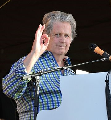 Brian Wilson gives the OK sign and a smile while performing as part of The Beach Boys 50th Anniversary Reunion at the New Orleans Jazz & Heritage Festival 2012. photo: Takahiro Kyono, Wikipedia.