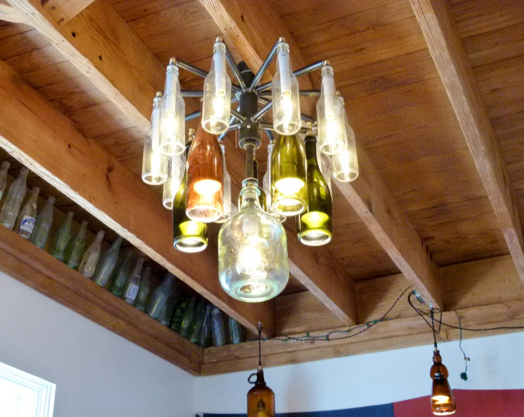 The restaurant features some creative lighting fixtures. Notice the light in the background made from an old maple syrup bottle.