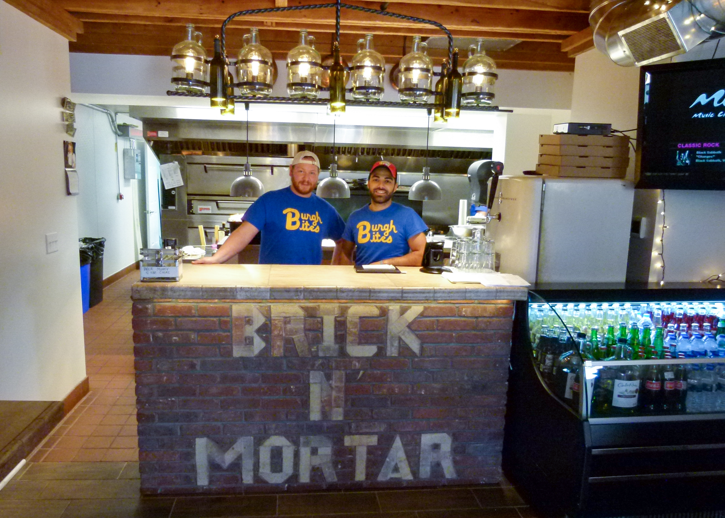 Head Chef Jon Tryc (L.) and owner Ricci Minella (R.) enjoy creating delicious food and interacting with customers.