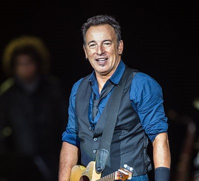 Bruce Springsteen with Guitar. Photo: Bill Ebbesen and Wikipedia.