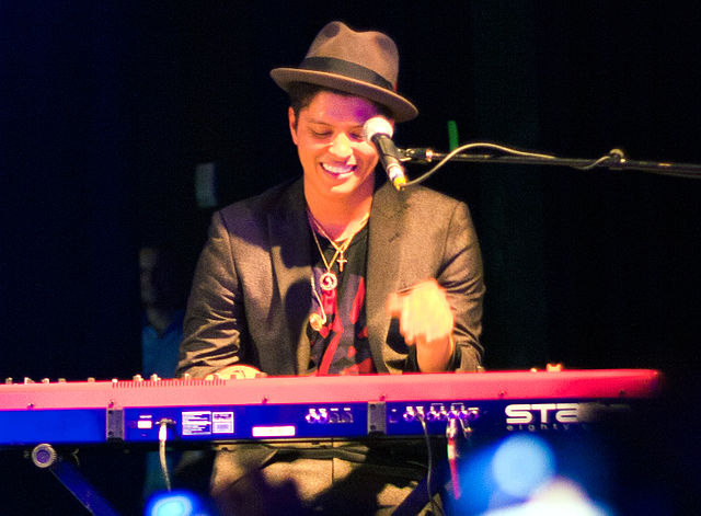 Bruno Mars playing keyboards at a Houston concert in 2010. Photo: Brothers Le and Wikipedia.