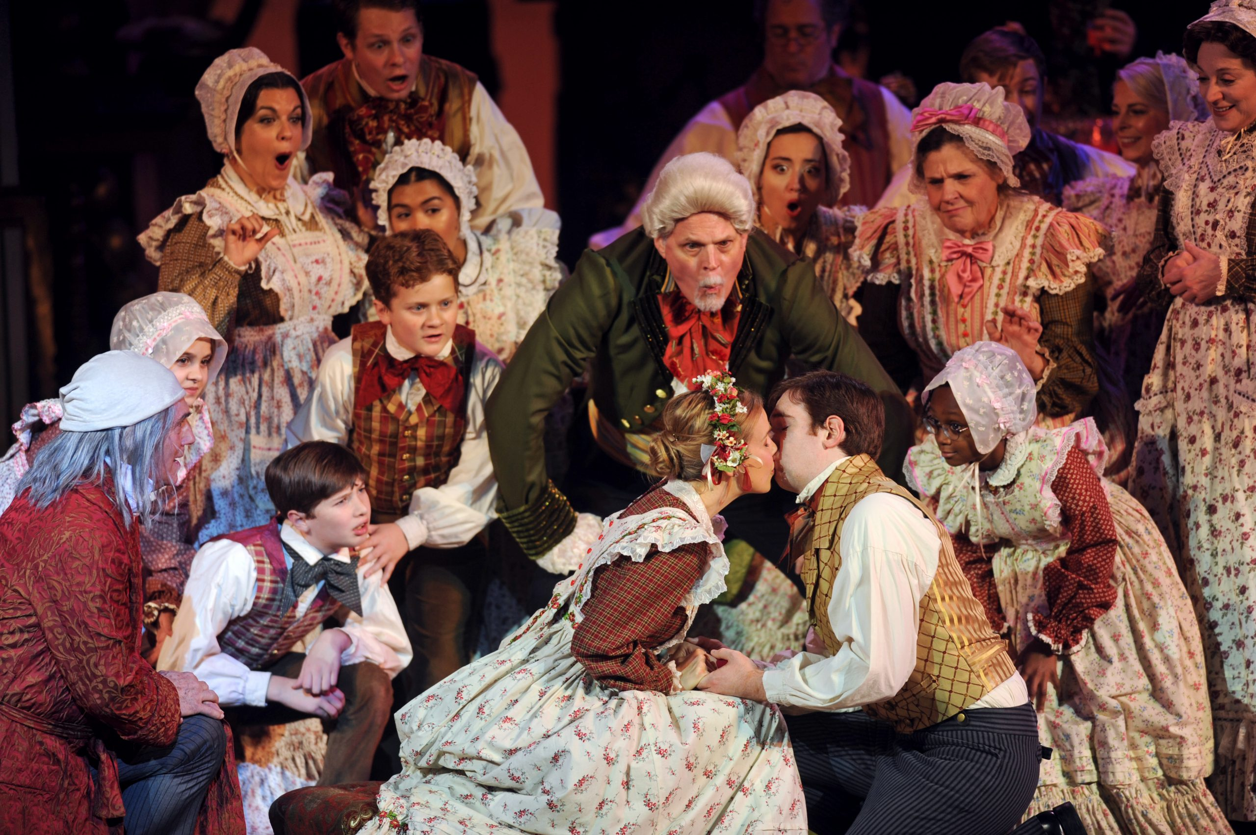 Tim Hartman, as Mr. Fezziwig, scrupulously supervises the kissing kiddies in Pittsburgh CLO's 'A Musical Christmas Carol.' The scene is from last year's production but Hartman, and the play, return this month. (photo: Matt Polk)