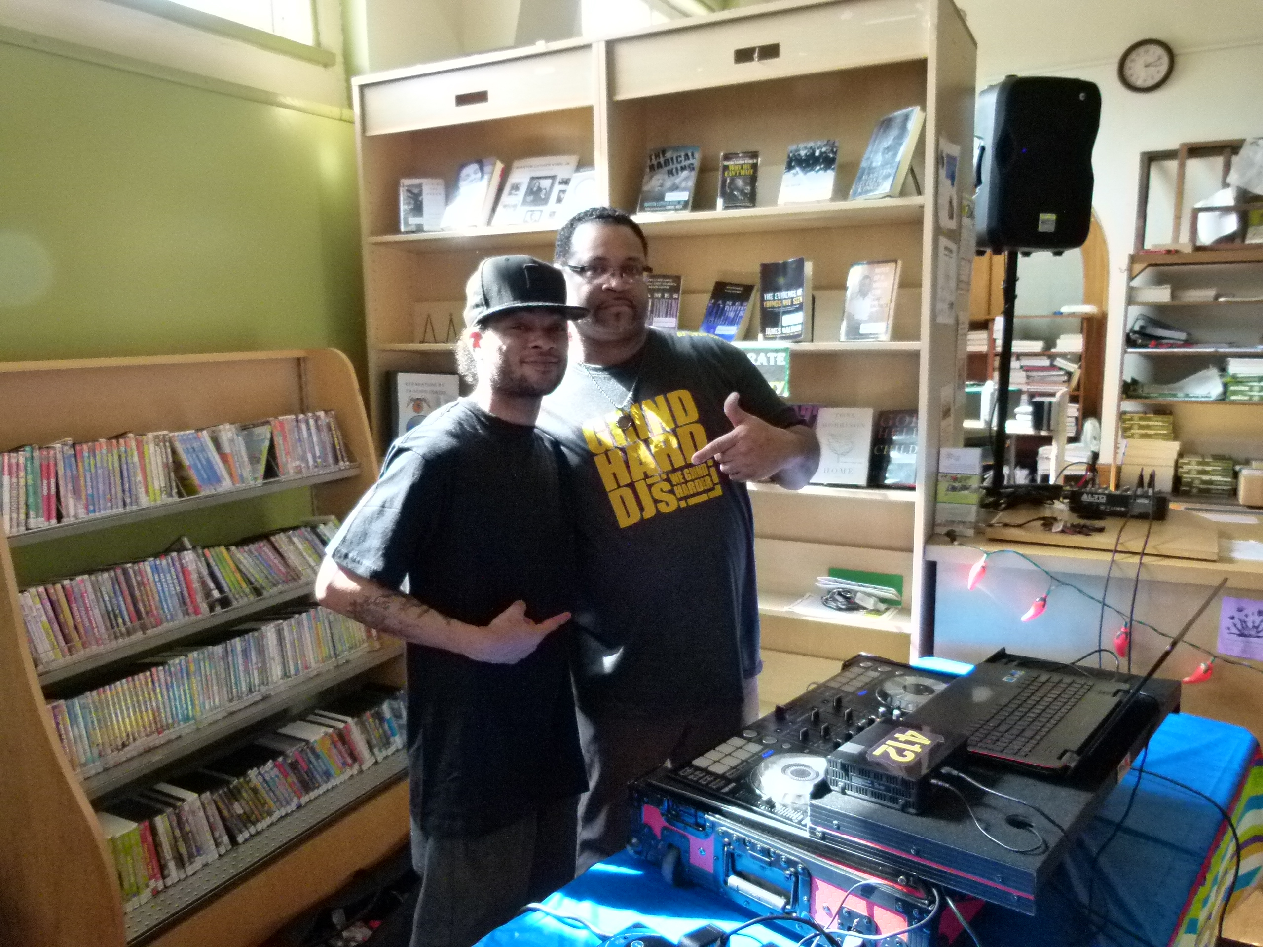 DJ Wyld Chyld (Sean Walker) (l.) and his protege Terance Boddy (r.) create the music mix for the event.