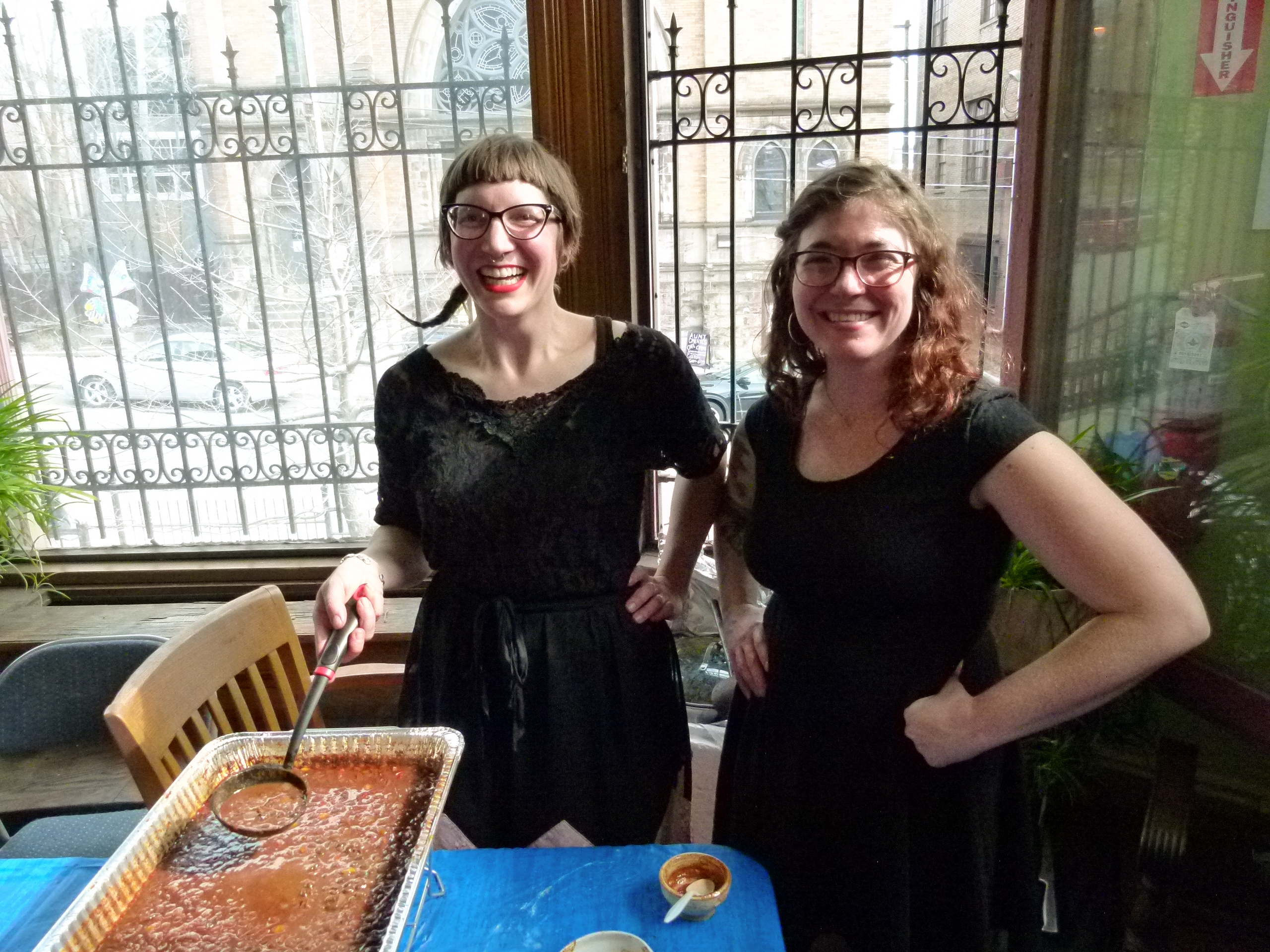 Hipsters make great chili too. Grizzemily (l.) is ready to scoop some of their Holy Mole! chili into a bowl while Katie Johnson (r.) stands ready to assist.