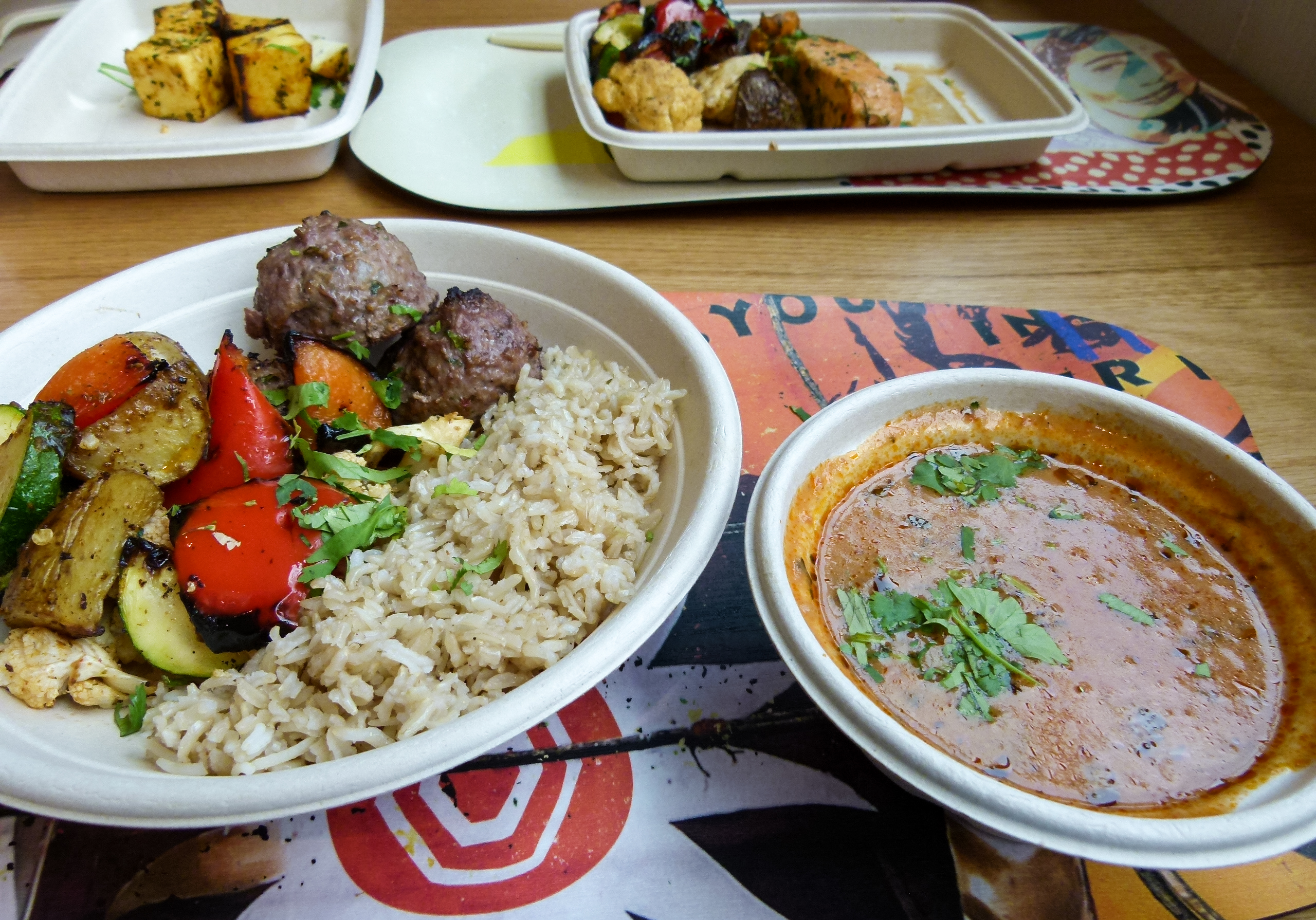 The Perfect Balance Bowl with lamb meatballs , rice and roasted veggies and the tikka maasala sauce on the side. There were three lamb meatballs, but one was eaten prior to the photo being taken.
