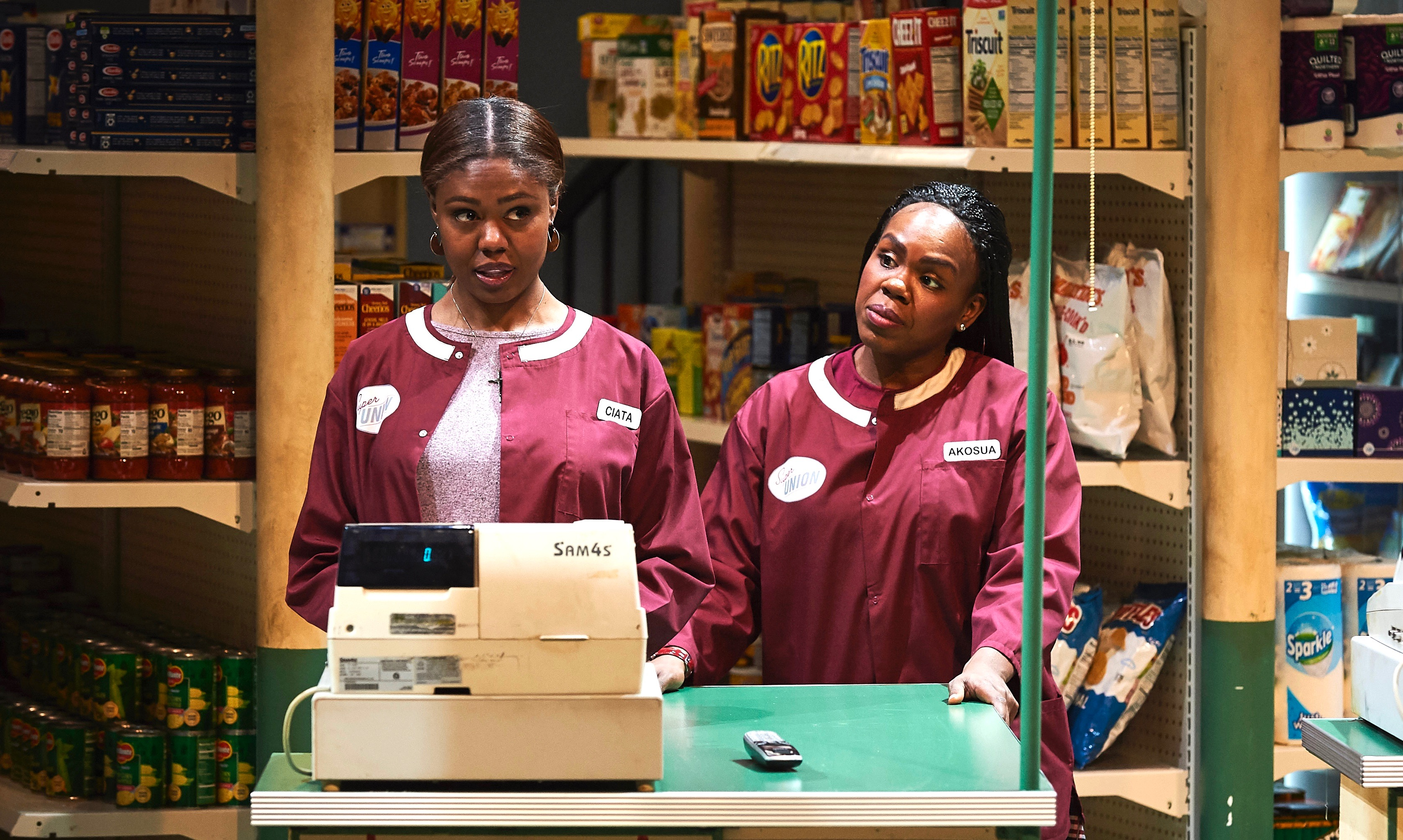 What'll you have? A better future, maybe? Ciata (Shamika Cotton, L) and Akosua (Ngoy Anyanwu) check out the prospects in 'Citizens Market.'
