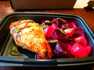 Honey chipotle glazed chicken breast with beet, apple, and pear salad.