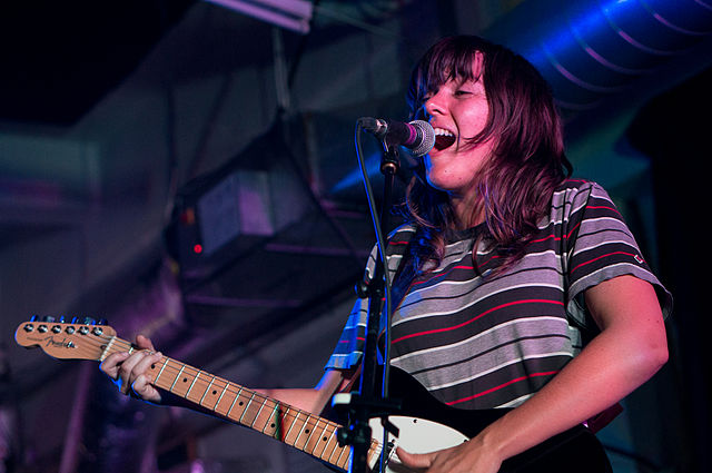 Courtney Barnett performing at a concert in 2015. (photo: Paul Hudson and Wikipedia)