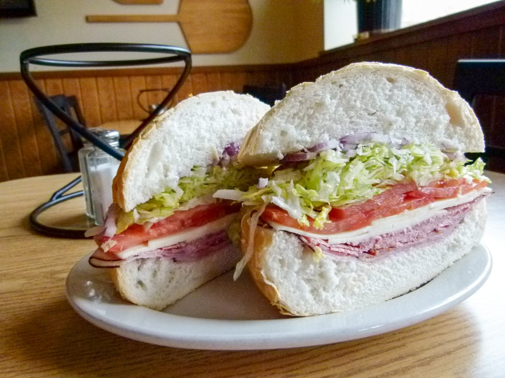 The Italian sandwich features savory Italian meats and cheese.