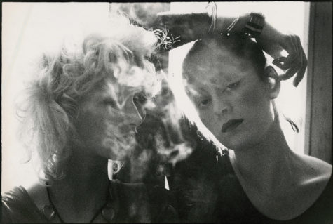 Return with us now to the smoky days of femininity past. Jane Forth (R) and Donna Jordan (behind the cloud) were actors and muses in the films and other doings of Andy Warhol and his circle. They're among the many figures featured in 'Femme Touch.' (photo: ca. 1970, Peter Beard, © 2019)