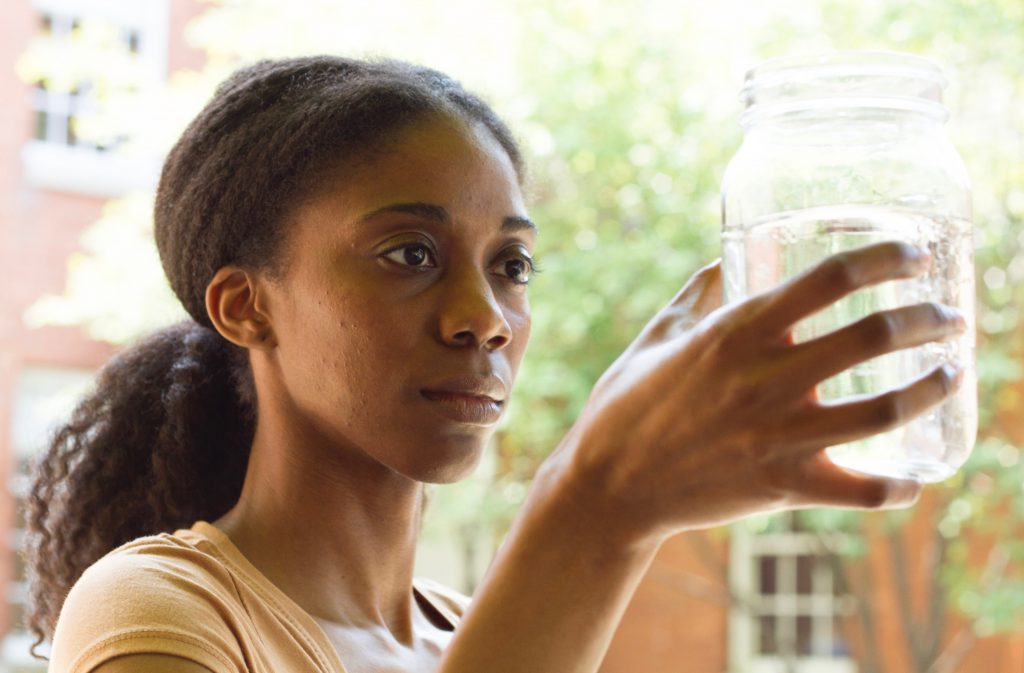 "The glass is more than half full, but of what? Sierra (Siovhan Christensen) contemplates the effects of fracking in ""Driftless."""