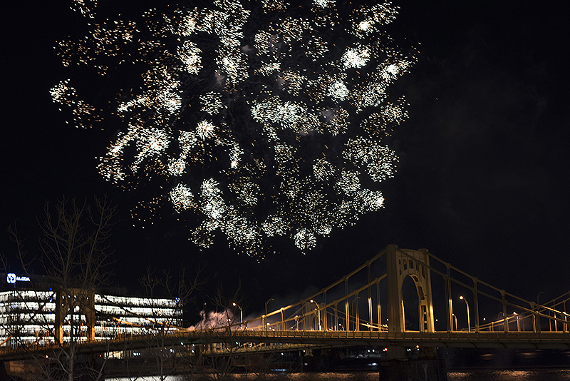 The Dollar Bank Children's Fireworks go off over the Andy Warhol Bridge as First Night gets under way.