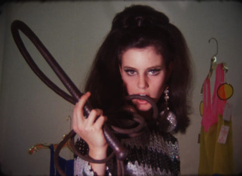 Oh, really, Susan? International Velvet, a.k.a. Susan Bottomly, brings a high coiffure and ham-handed acting to the party in Warhol's short film 'Paraphernalia.' (still frame © The Andy Warhol Museum)