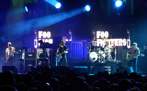 Foo Fighters performing in November 2007. From left to right: Chris Shiflett, Dave Grohl, Taylor Hawkins and Nate Mendel. photo by mojo-jo-jo.