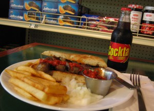 Here's the Cevapi (on homemade Lepina bread) with sides of French fries, onions, and Ajvar. The Cockta is a rose-hip-based soft drink from Slovenia.