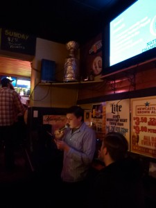 "Co-host Mike ""Marty"" Stanis calls out a round one question while Anthony Fennessy prepares to do the same in round two."