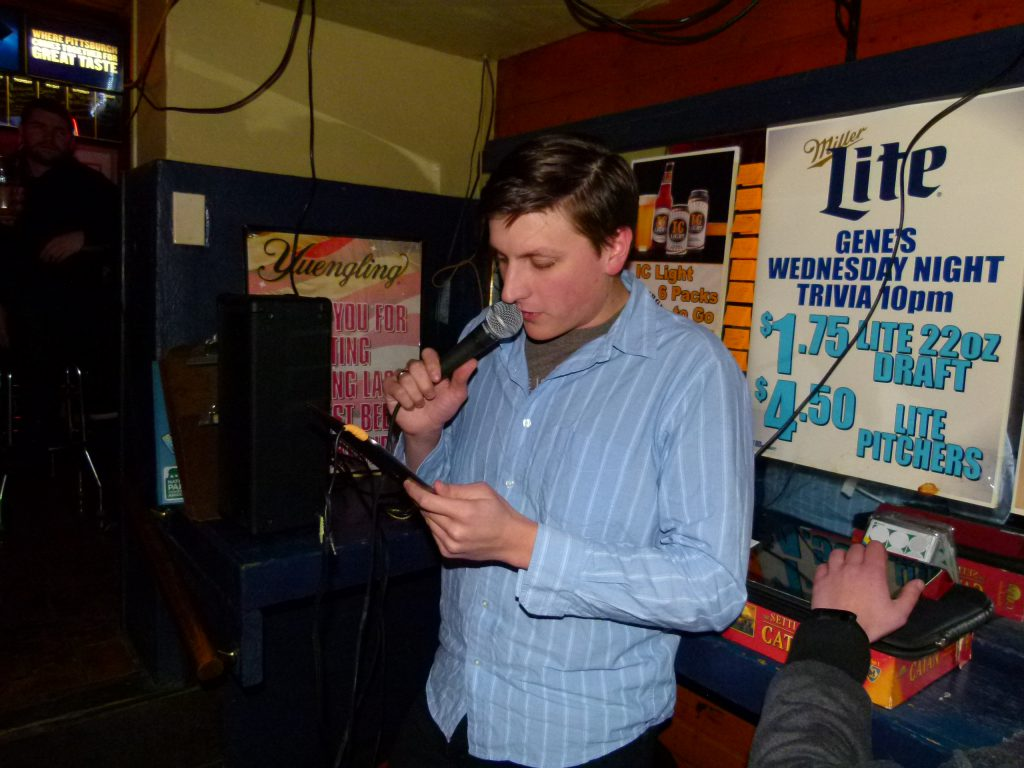 "Co-host Mike ""Marty"" Stanis calls out a round one question at Gene's Place Trivia Night."