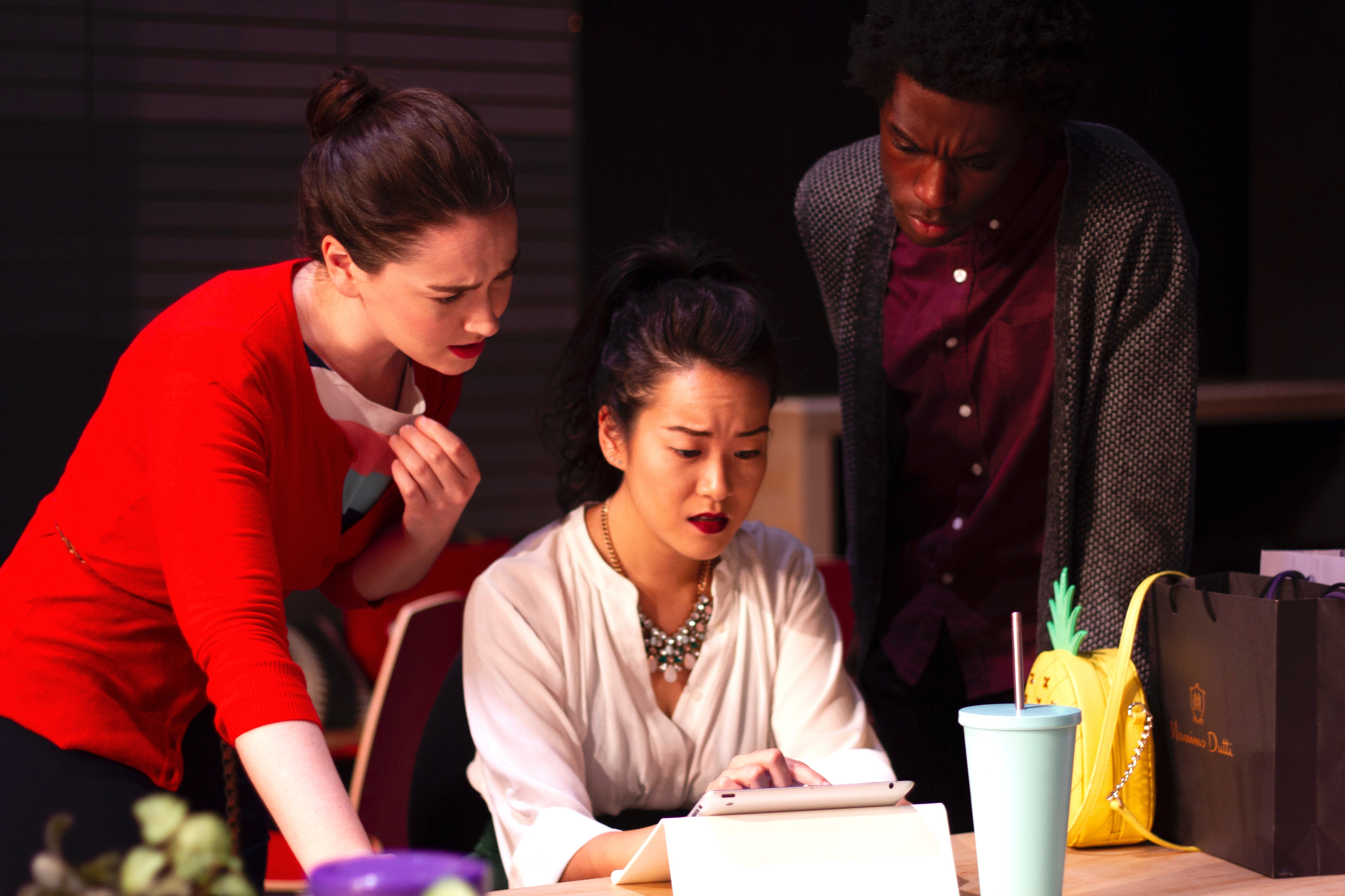 You've seen stock photos of happy office workers and they do not look like this. Actors Moira Quigley, Sami Ma, and Dylan T. Jackson ponder troubling issues in Hatch's 'Gloria.'