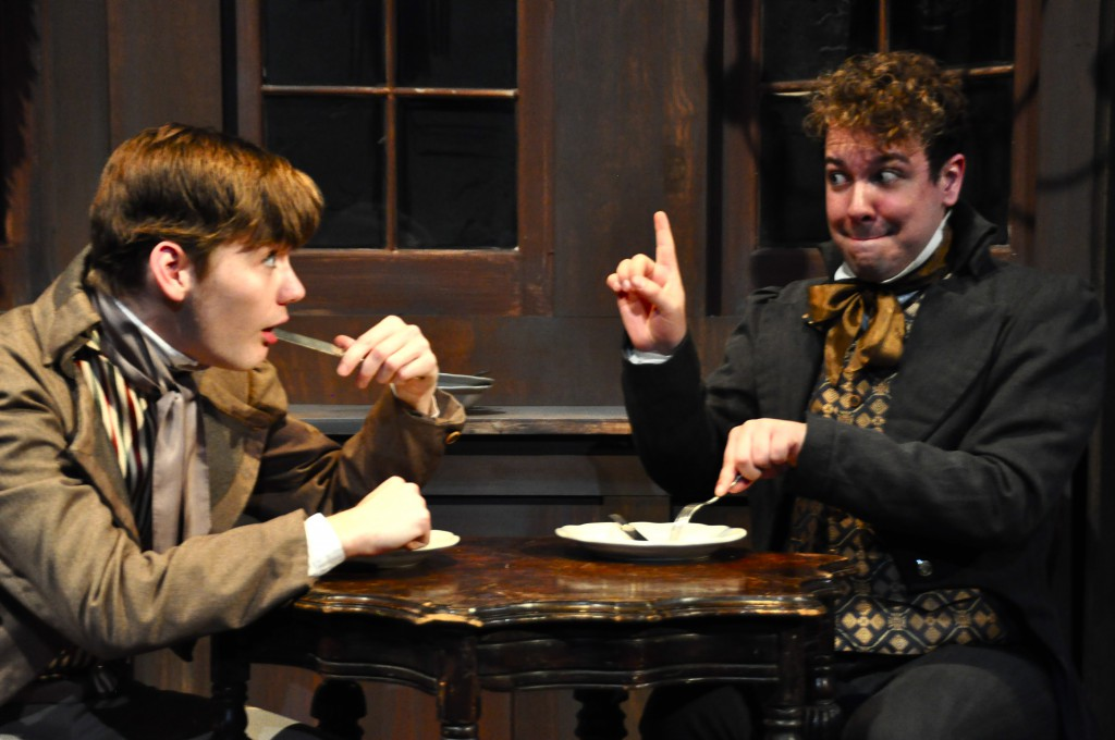 "In PICT's ""Great Expectations,"" young Pip (Dylan Marquis Meyers, L) learns gentlemanly table manners from Herbert Pocket (Jordan Ross Weinhold). Photo: Suellen Fitzsimmons."